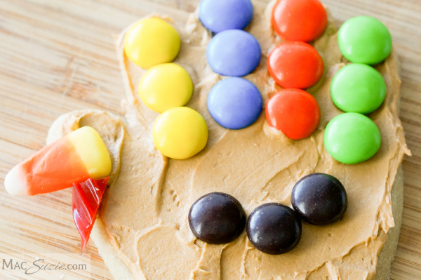 MacSuzie| Thanksgiving Turkey Cookies - A bit of frosting and candy transform hand print cookies into festive turkeys!