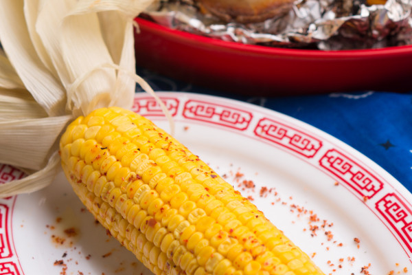 MacSuzie | Tin Foil Potatoes & In-Husk Roasted Corn - These two cookout sides are about as easy as it gets. Cheap ingredients + lots of flavor + minimal cleanup = a happy hostess!!!